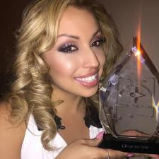 Ernestine Romero holds her award for CD Of The Year at the 25th Annual New Mexico Hispano Music Awards in Espanola, NM on Saturdy, January 16, 2016. (Facebook)
