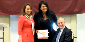 Suzette Quintanilla-Arriaga (center) with Texas Governor Greg Abbot (right) and First Lady Cecilia Abbott (left) at Texas Women's Hall of Fame ceremony in Denton, Texas on October 21, 2016. (Livestream)
