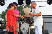 Little Joe receives proclamation from Temple mayor pro tem Judy Morales and former Temple mayor Danny Dunn (Photo by John John Montelongo)